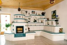 Cob house built in shelves & stove with blue tiles - so pretty! Home Furnace, Rocket Mass Heater, Earth Bag Homes, Outdoor Oven, Rustic Fireplaces, Rocket Stoves, Home Design, My Dream Home, Home Goods