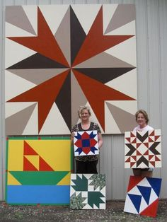 Barn Quilts - love the brown/maroon ones. Hang on the house?
