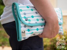 ** As seen on Mums Grapevine **  This functional and fashionable nappy clutch is a must-have accessory for every mum! Perfect for that quick trip out, or for keeping in the car or the bottom of the buggy/stroller. Great for when you dont want to take a large nappy bag with you. A thoughtful gift for mums-to-be, baby showers, grandparents or a treat for a hard working mum!  It has two large pockets, which fit 2-3 disposable nappies, wipes, disposable change mat and other small accessories you…