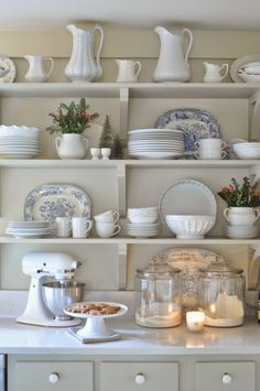 White dinnerware with blue and white platters with a little greenery.  NINE + SIXTEEN