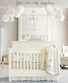 baby nursery with symmetrical poms