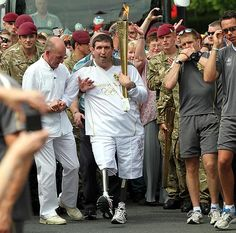 Ben Parkinson, the most seriously wounded soldier to survive the war in Afghanistan, carrying Olympic torch