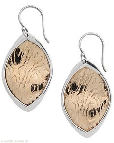 Like these earrings from Silpada...   Bronze, Sterling Silver.
