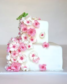 spring flowers and butterfly - two tiered square cake with pink and white gumpaste flowers and a gelatin butterfly