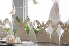 A white angel-shaped table decoration.