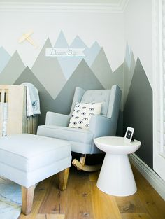 blue and gray nursery with a mountain mural