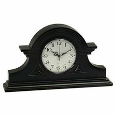 """Mantel clock with molding accents.  Product: Mantel clockConstruction Material: MDF and glassColor: Black and whiteAccommodates: Batteries - not includedDimensions: 8.5"""" H x 15"""" W x 2.75"""" D"""