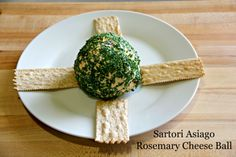 8 oz. cream cheese 1/4 cup Rosemary and Olive Oil Asiago, grated 1/8  tsp. garlic powder 1/8 tsp. shallots, minced 1/8 cup Cooked bacon minced 20g 2 tbsp. fresh parsley, chopped 3 tbsp. fresh chives  In a medium bowl, blend cream cheese until smooth. Mix in Sartori Rosemary and Olive Oil Asiago, garlic powder, shallots and bacon. Form the mixture into a ball shape. Cover and refrigerate for 3 hours, or until firm. Mix parsley and chives and roll cheese ball in mixture. Serve at room…
