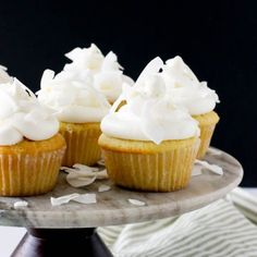 These light-as-air coconut cupcakes have coconut milk and shredded coconut for extra flavor, and a creamy coconut buttercream frosting.