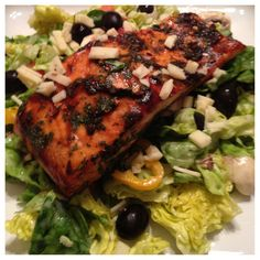 BBQ cilantro salmon on butter lettuce, orange pepper, tomato, mushroom and olive salad with sweet onion dressing.