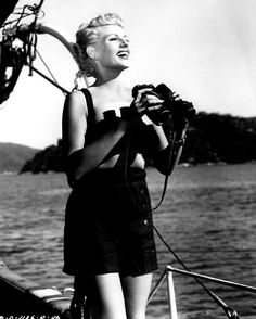 Rita Hayworth having fun behind the scenes of The Lady From Shanghai on Errol Flynn's boat, Acapulco, Mexico, circa 1947.