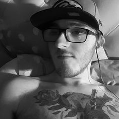 Relax before work. Long night ahead. #rad #selfie #guyswithglasses #guyswithtattoos #guyswithbeards #denverbroncos #newera #cap #fitted