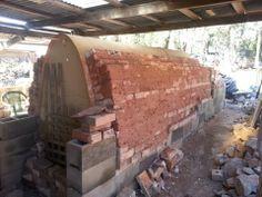 Lise Edwards' kiln rebuild progress; bricks to the arch form, Australia