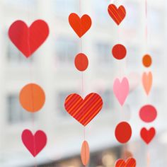 An easy DIY paper heart garland with printables and tutorial!