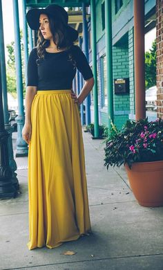 A classy and modest mustard maxi skirt with hidden back zipper and fully lined. Shop modest and trendy dresses for work wear, office fashion, church wear and casual occasions by Apostolic Clothing Co. Yellow Maxi Skirts, Maxi Skirt Outfits, Winter Skirt Outfit, Modest Skirts, Modest Outfits, Long Skirts, Pleated Maxi Skirts, Midi Skirt, Applique Skirt