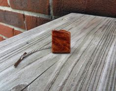 For just $31.00, you could own your very own Amboyna Burl Wood Tie Tack Handmade by TennesseeWoodShop on Etsy!