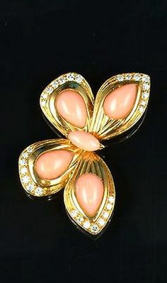 A coral and diamond butterfly brooch, by Van Cleef & Arpels