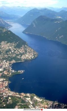 Lake Lugano as seen out of the airplane ;-) Lugano on the left. The photo is taken from south to north-east view, so at the far end of the lake is Porlezza, Italy. Monte Brè is the steep hill in the centre of the photo.Close to the horizon , a glimpse of Lake Como in Italy can be seen.  Enjoy!