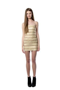 Gold stretch - knit dress  This gold stretch – knit dress is designed to sculpt and define your silhouette in the most flattering way. The mini style strapless piece is made to highlight your décolletage. Team yours with simple accessory and heels.