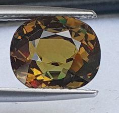 4.87cts, Demantoid Green Garnet, Certified,  VVS Eye Clean 1,  Untreated gemstones