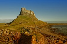 Lindisfarne Castle is a castle located on Holy Island, on the North East coast of England close to the Border with Scotland. King Henry VIII ordered it to be built in 1542 to protect England from the Scottish invaders...