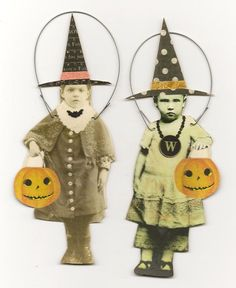 vintage Halloween ornaments.  I can see me sticking my grandkids heads on these.