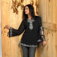 Bell sleeve Stone Work Ladies Blouse Tunic Top Kurta Kurti Haas Fashion. $65.00. Poly Viscose. Inner Lining to be avoid embroiderey itchiness.If you don't want the inner lining,Kindly inform us while you place the order.. Poly Viscose. Thigh length Bell Sleeve top. Designer Ladies Blouses /Tunics/ Tops. Stone Work