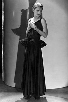 Lee Miller, 1931. In a black satin gown by jeanne lanvin & boucheron jewels for vogue, photograph by edward steichen