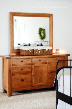 I try to keep the dresser clear of clutter. The baskets, from target, are used for my perfume, candles,  and e readers.  The dresser can be the biggest clutter magnet in the room.  Try to keep it nicely organizedHow to organize the master bedroom |