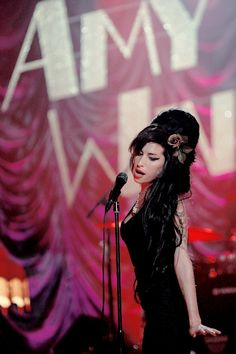 """ Amy Winehouse performing 'Rehab' live at the 50th Annual Grammy Awards."""