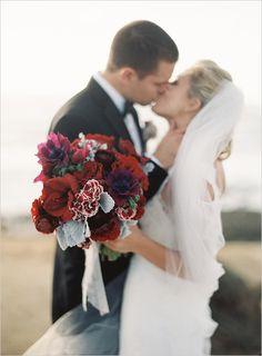 Red wedding bouquet by Oak and the Owl. #wedding #bride #bouquet http://www.weddingchicks.com/2013/07/30/california-wedding/