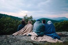 Watching the sun rise at the top of a mountain snuggling close together and feeling the warmth from your favourite people around you