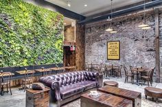 Green Wall - Botica Del Cafe's cozy interior is not only designed with comfort in mind but also features a sustainable green wall installation. The breath...