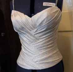 Sections of fabric were pleated, steamed, sewn on a corset base, then excess fabric was trimmed from each band before the next was added. Two back halves were pleated, steamed, and sewn to each side. Translation - http://translate.google.com/translate?sl=auto&tl=en&js=n&prev=_t&hl=en&ie=UTF-8&u=http%3A%2F%2Fwww.liveinternet.ru%2Fusers%2Fhodusyata%2Fpost214036732%2F