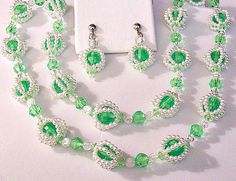 Green clear hard plastic faceted assorted size beads surrounded by white small pearl seed beads clear faceted round accent beads necklace choker matching clip on earrings dangle beads. Necklace measures 28 inches long earrings are 1 3/4 inches long. In excellent vintage condition. Choose Necklace or Earrings.  Available: 1 - Necklace Choker 1 - Clip On Earrings See more vintage items here: Vintage Earrings - http://etsy.me/1HcH8nv Vintage Necklaces - http://etsy....