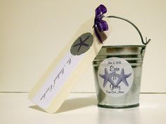 #Starfish #candle #favor for a beach #wedding.  This tiny aluminum bucket (from Amazon, about $8 for a dozen) contains a Yankee Candle votive in Lilac Blossoms.  The name tag is decorated with a paper-punched sand dollar (from Michaels).  It doubles as a favor and a place card!