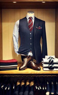 Jacket half on. Folded shirts + 1 tie.