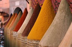 I want to buy spices and carpets and fabric in Marrakesh; Eat tagine, drink things I can't spell and feel the heat from sun-baked bricks.