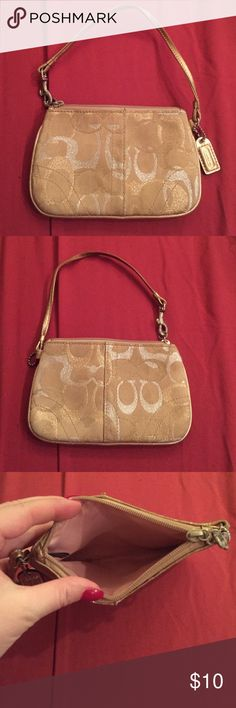 Coach wristlet Small gold & silver wristlet. Perfect for on the go when you don't need a lot. Coach Bags Clutches & Wristlets