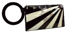 9.5 inches x 5 inches    Hand crafted with black and white shells in a gorgeous design!