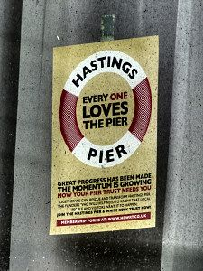 One of the many posters showing support for the campaign to save Hastings Pier that had been organised by HPWRT (Hastings Pier and White Rock Trust) before the fire. Hastings Pier, Hastings East Sussex, Seaside, First Love, Trust, Campaign, England, Fire, Posters