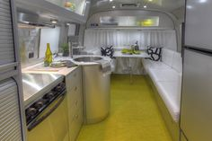 Airstream has partnered once again with architect Christopher Deam to release the Airstream Sterling Concept Trailer, a striking and modern design that calls to mind the interior of a high-tech aircraft mixed with the comfort of a mid-century modern home.