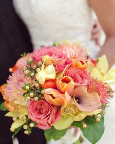 This pink wedding bouquet is stunning for a summer wedding. We love the variety of hues and those sweet pops of pale yellow.