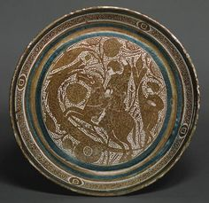 Basin with a Horseman Spearing a Serpent, 1390–1400  Spanish (Valencia?)  Lustered earthenware