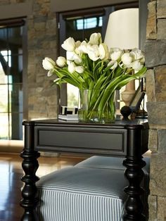 tulips-white on this gorgeous black table. This shows how stunning black and white are together.