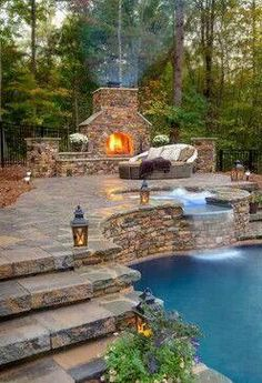 Beautiful backyard pool and fireplace.