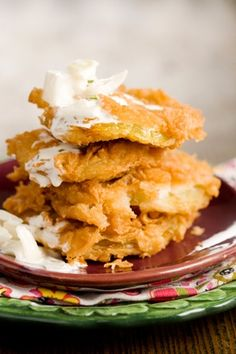 Paula Deen's Fried Green Tomatoes! Love this recipe although I like to add cornmeal to my flour mixture for an extra added crunch. I like this recipe because I think it's key to let the tomatoes sit with salt so that it pull excess water out of the tomatoes. Soggy fried green tomatoes are never any fun. Don't forget to brew up some sweet tea along with this.