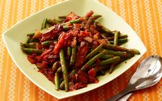 Ree Drummond, aka the Pioneer Woman, serves these Green Beans & Tomatoes on Thanksgiving.