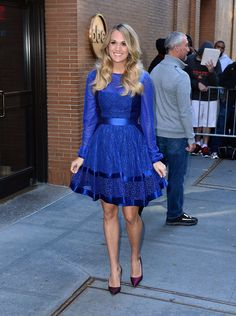 Pin for Later: Carrie Underwood Doesn't Like Wearing Maternity Clothes  The singer first showed off her teeny tiny bump in a blue, fit-and-flare Temperley London dress.