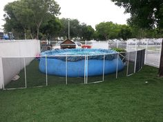 Above Ground Pool Fence Ideas above ground pool designs google search Black Mesh Pool Fence With White Poles Installed In Grass For Above Ground Pool Above